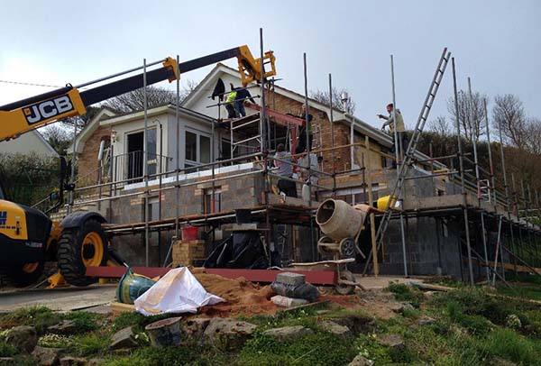 builders carrying out an extension